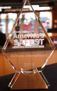 "A picture of a clear plexiglass EHS award emblazonded with ""America's Safest.""."